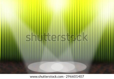 Green rising curtain with spotlight - stock photo