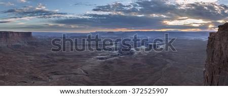 Green River overlook, Canyonlands National Park at sunset panorama - stock photo