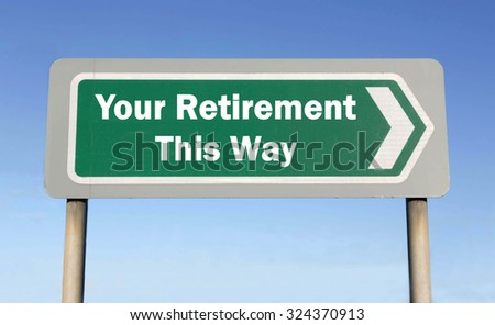 Green road sign with the message of This Way for Your Retirement concept against a blue sky background - stock photo