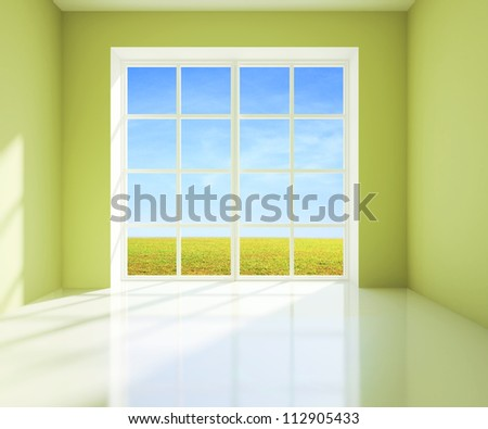 green room with a view of field from window - stock photo