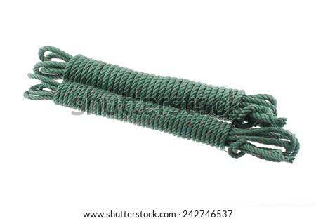 Green ropes on white background. - stock photo