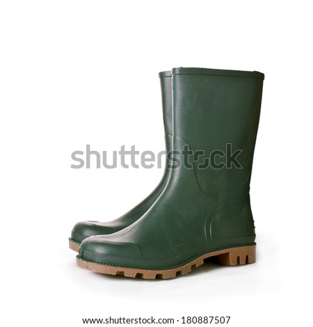 Green rubber boots on white background. Agricultural working boots for garden. - stock photo