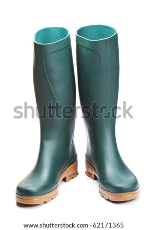 Green rubber boots with soft shadow on white background - stock photo