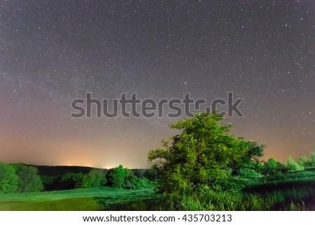 green rural fields at the dark night - stock photo