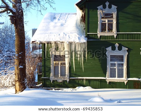 Green rural house - stock photo