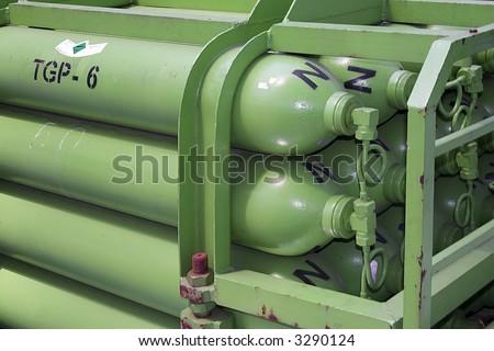 Green rusty gas tanks - stock photo