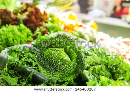 Green salad at marketplace. - stock photo