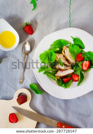 green salad with chicken and strawberry. healthy food. style vintage. top view.selective focus - stock photo