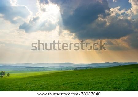 Green scene with dramatic sky - stock photo