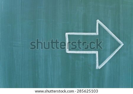 Green school chalkboard with arrow - stock photo