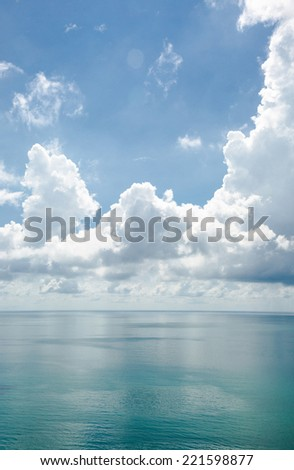 Green sea and white cloud under sunshine - stock photo