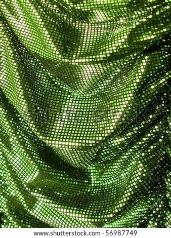 Green sequin background. More of this motif & more textiles in my port. - stock photo