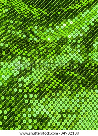 Green sequin sparkling textile closeup. More of this motif & more textures in my port. - stock photo