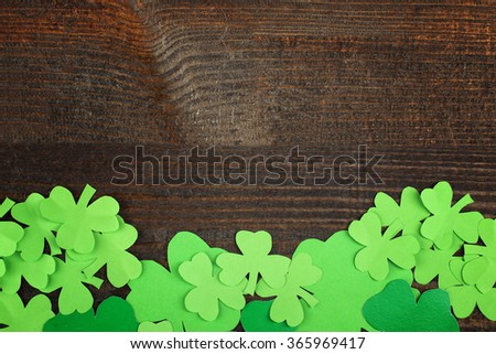 Green Shamrocks clovers on wooden background . Background for St. Patrick's Day celebration - stock photo