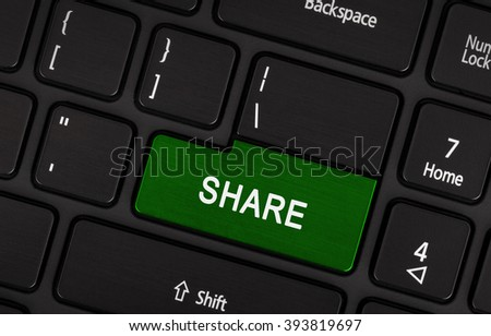 Green share button on a laptop keyboard - stock photo