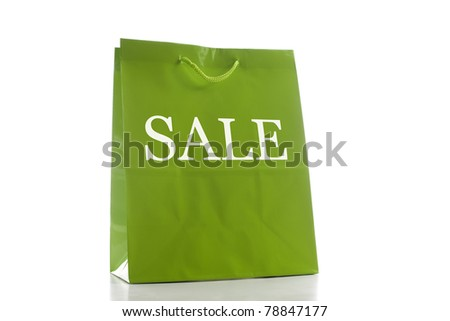 Green shopping back front angled with a slight drop shadow. - stock photo