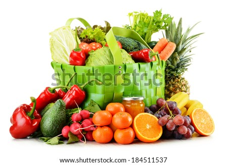 Green shopping bag with groceries isolated on white background - stock photo