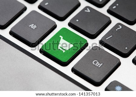 Green Shopping button key on laptop keyboard - stock photo