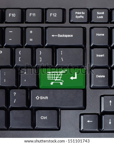 Green shopping key on the keyboard, close-up - stock photo