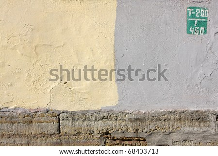 Green sign on a wall of yellow and gray color - stock photo