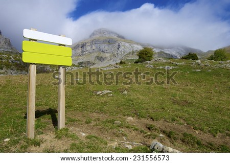 green signboard in the Pyrenees mountains, Spain - stock photo