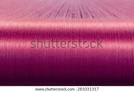 Green silk on a warping loom of a textile mill, Silk for weaving on a hand loom - stock photo
