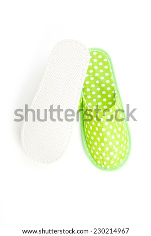 Green slippers on a white background - stock photo