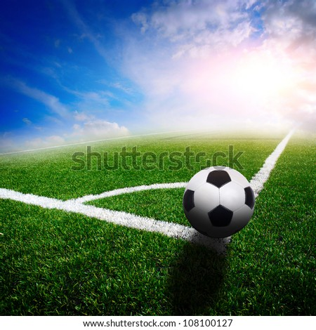 green soccer field with the blue sky - stock photo