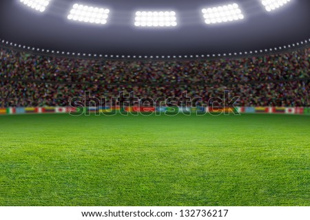 Green soccer stadium, illuminated field, arena in night - stock photo