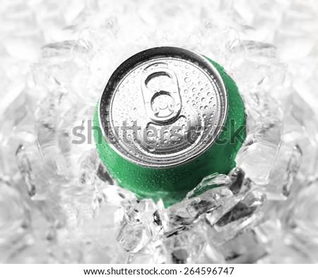Green soda can in ice  - stock photo