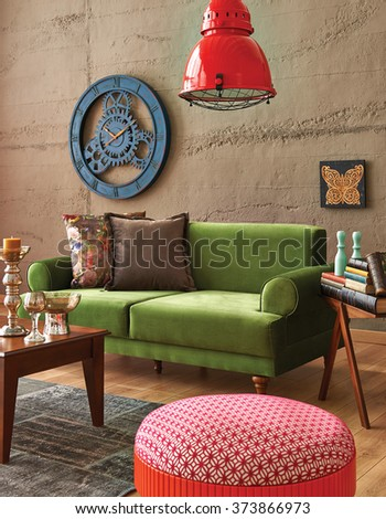 green sofa stone wall with modern red lamp  - stock photo
