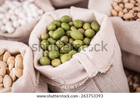 green soy beans and cereals in bag studio shot - stock photo