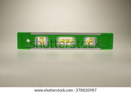 Green spirit level isolated on white background. - stock photo