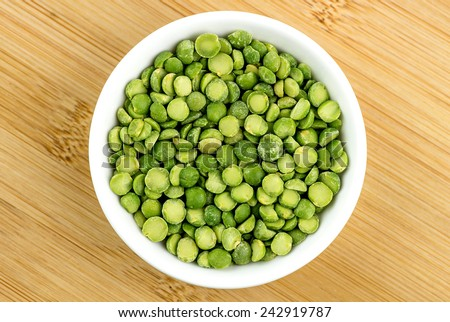 Green split peas in bowl - stock photo
