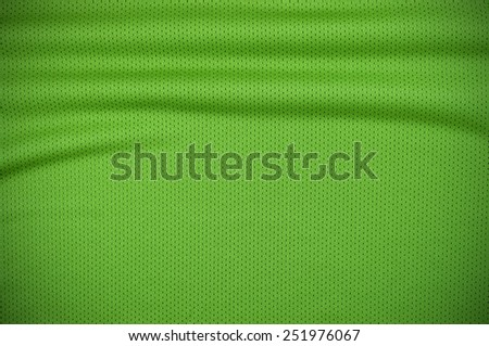 Green sport jersey shirt clothing texture and background - stock photo