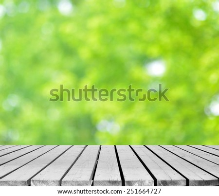 Green spring background with wooden platform  - stock photo
