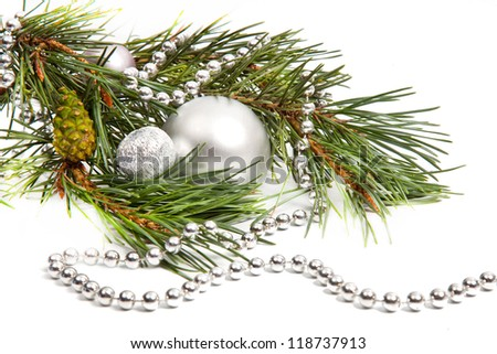 Green spruce twig with Christmas balls and decoration isolated on white - stock photo