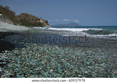 Green stones beach on Flores - stock photo