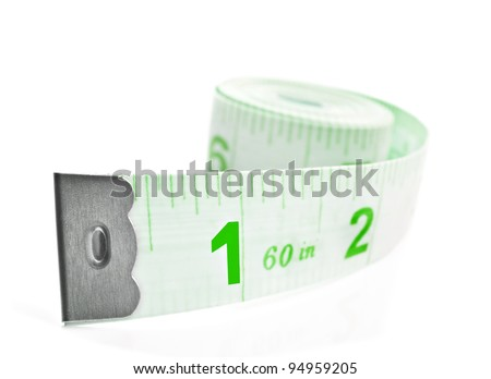 Green tape measure on white background - stock photo