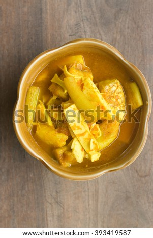 green taro stalk sour soup with fillet fish. Kaeng som okdip. - stock photo