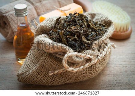 green tea, a towel on the bamboo mat, spa concept - stock photo