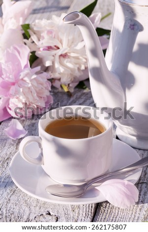 Green tea and peony flower. - stock photo
