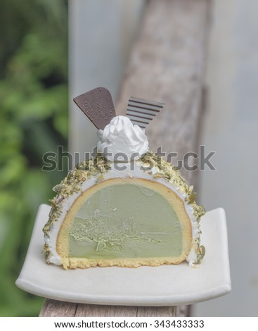 Green tea cake, tea and cake in white plate. on nature background.select focus.  - stock photo