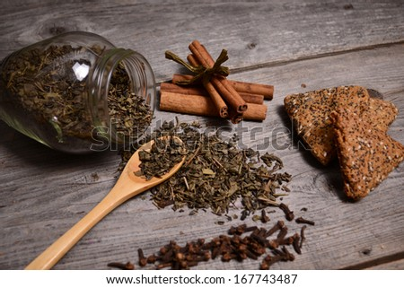 Green Tea, cookies and cinnamon close up - stock photo