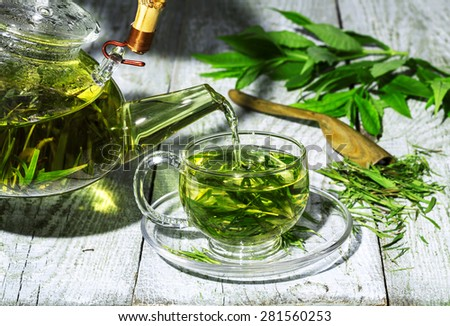 Green tea in a glass cup on the table. - stock photo
