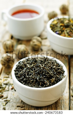 green tea in a white bowl on a dark wood background. tinting. selective focus - stock photo