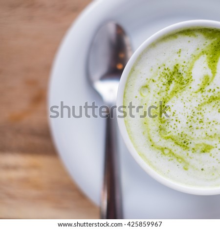 green tea latte  - matcha green tea on wood background, selective focus. - stock photo
