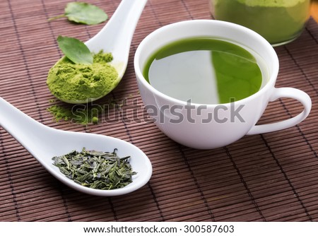 Green tea n the brown mat close-up - stock photo