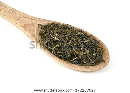 Green tea on a wooden spoon. Type is spring bud green tea - stock photo