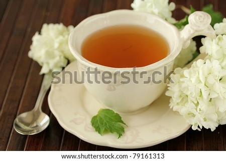 green tea on a wooden table,shallow dof - stock photo